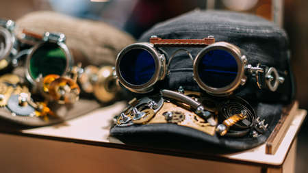 Cap of metal parts and glasses in the style of steampunk.