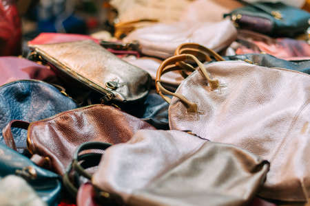 Handmade leather womens bags on lie in the store.