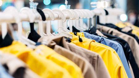 Summer nylon jackets hang on hangers in the showroom.