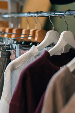 Craft vintage linen clothes hanging on hangers in the store. 写真素材