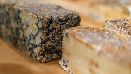 Handmade blue cheese chunks on the counter. 写真素材