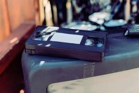 Old video tape VHS lies on TV.