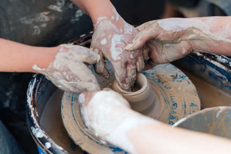 Master class on teaching pottery. Hands create a clay figure. 写真素材