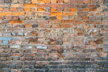 Old crumbling brick wall as background close up. 写真素材
