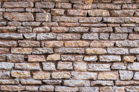 Old brick and stone wall as background. 写真素材