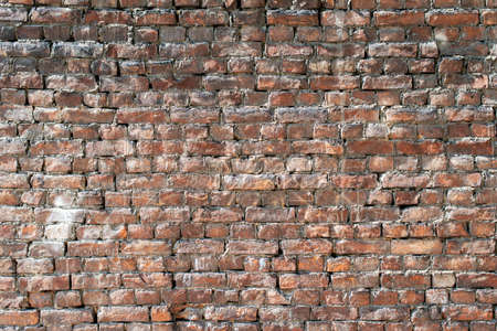 Old brick wall with bulging parts as background. 写真素材