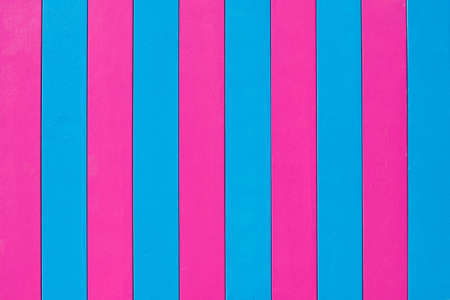 Wooden background of pink and blue shades. 写真素材