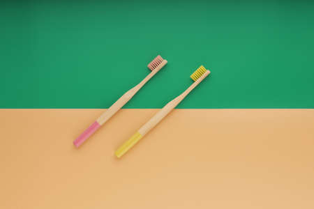 Wooden toothbrushes on color background