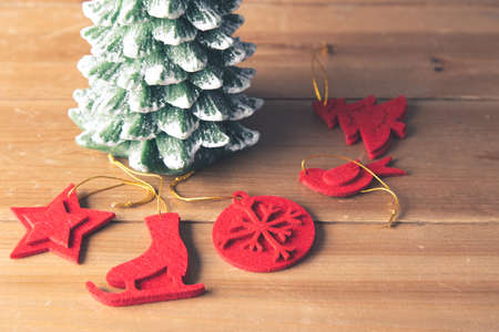 Christmas decoration on a wooden craft table in a family's home for Christmas and New Years Eve