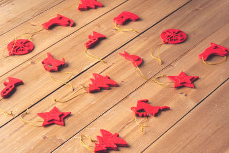 Christmas decoration on a wooden craft table in a family's home for Christmas and New Years Eve Standard-Bild