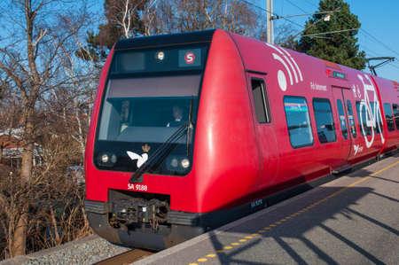 Copenhagen Denmark - Marts 23. 2012: Danish DSB s-train in red which serves passengers of Copenhagen and its suburbs