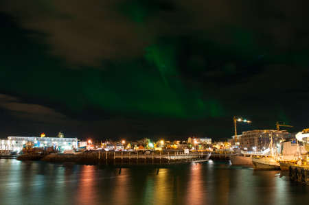 northern light: Aurora borealis in Reykjavik harbor in Iceland Stock Photo