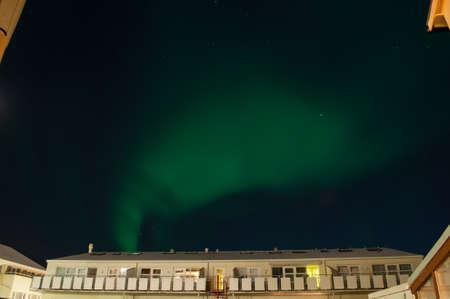 aurora borealis over a building in Reykjavik Iceland