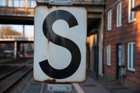 S Stop sign at Danish Train Station