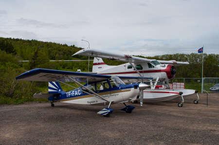 Akureyri Iceland - June 20. 2015: Two airplanes parked at Akureyri airport