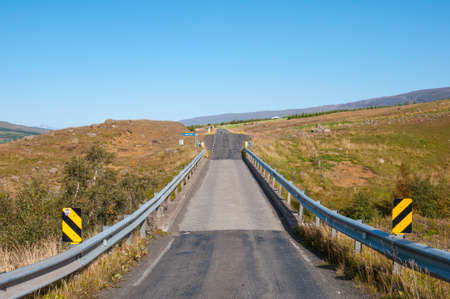 Bridge on an Icelandic countryside road on a summer day