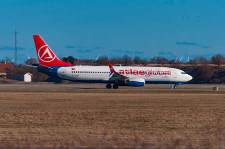 Copenhagen Denmark - March 17. 2018: Boeing 737-800 from turkish airline Atlas Global taxiing for take off at Copenhagen Airport Editorial