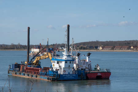 Vordingborg Denmark - April 6. 2018: Marcos a multipurpose construction vessel with a hydraulic excavator Editorial