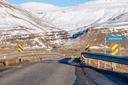 single lane bridge crossing river Hoffelsa in Hornafjordur in south Iceland on a sunny winter day Stock Photo