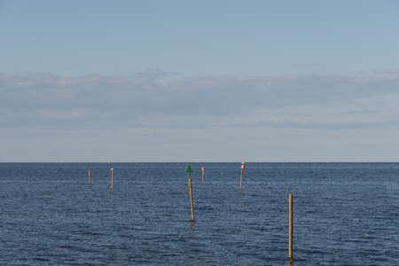 Homemade navigation markings in the sea of Denmark Stock Photo