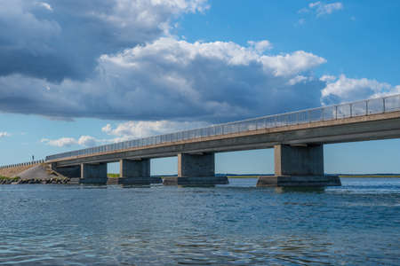 The bridge to island of Nyord in the Danish countryside Stock Photo - 131320950