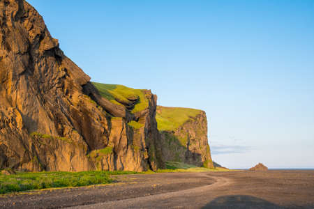 Hjorleifshofdi, a historical promontory in south Iceland on a sunny summer evening Stock Photo - 131320949