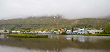 Old buildings near the lake in town of Seydisfjordur in east Iceland Stock Photo - 131320958
