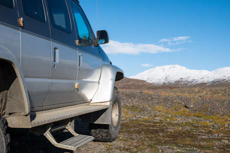 Modified 4x4 van in the Icelandic highlands on a sunny autumn day