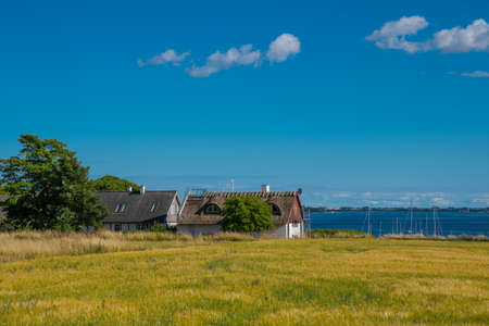 The village on island of Nyord on the Danish countryside on a sunny summer day Stock Photo - 131320984