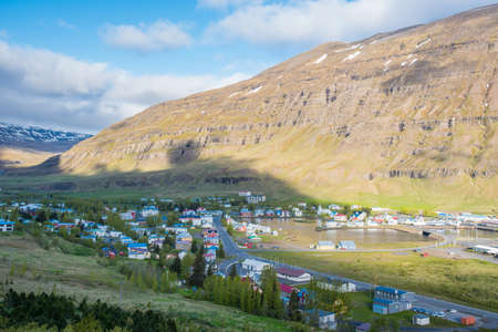 View over town of Seydisfjordur in east Iceland on a sunny summer morning Stock Photo - 131320985