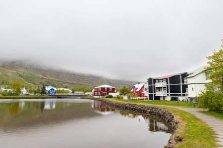 Old buildings near the lake in town of Seydisfjordur in east Iceland