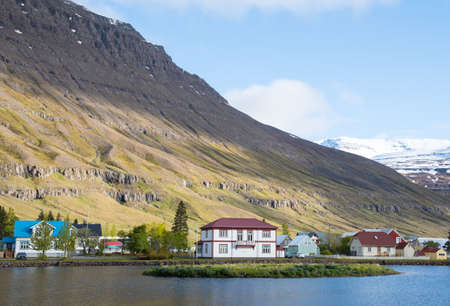 Old buildings near the lake in town of Seydisfjordur in east Iceland Stock Photo - 131320991