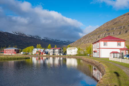 Old buildings near the lake in town of Seydisfjordur in east Iceland Stock Photo - 131320997