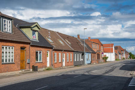 old houses along a street in city of Vordingborg in Denmark Stock Photo