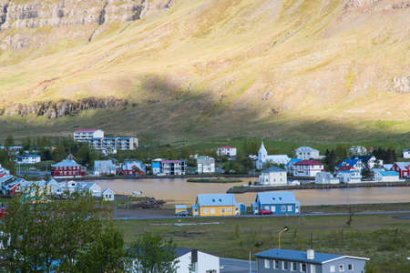 View over town of Seydisfjordur in east Iceland on a sunny summer morning Stock Photo - 131321010