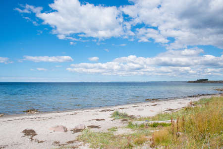View towards te sea from Svino beach on the Danish countryside on a sunny summer day Stock Photo