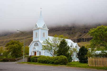 The church in town of seydisfjordur in Iceland on a cloudy evening Stock Photo - 131321339