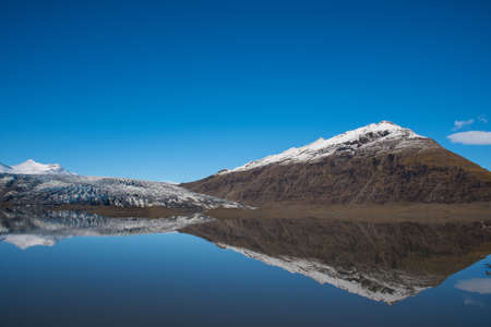 River Holmsa, Glacier Flaajokull and mountain and Flafjall mountain on a summer day in south Iceland Stock Photo