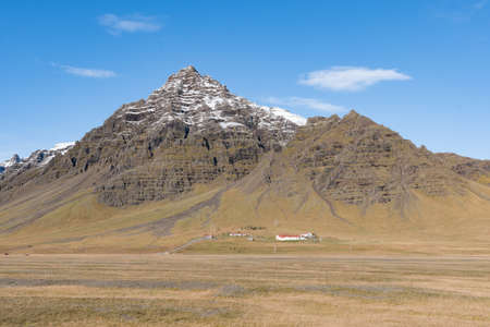 Farm in Kalfafellsdalur Valley in south Iceland on a sunny day