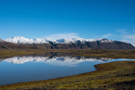 River Holmsa, Glacier Flaajokull and mountain and Flafjall mountain on a summer day in south Iceland Stock Photo - 131321381