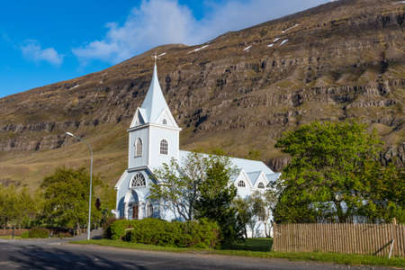 The church in town of seydisfjordur in Iceland on a sunny morning