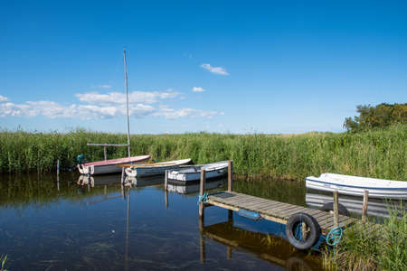 small boats in a natural port on Ulvshale peninsula on island of Moen in Denmark on a summer day Stock Photo - 131321423