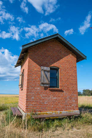 Pilot house lookout on island of Nyord in Denmark on a sunny summer day Stock Photo - 131321433