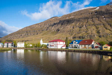 Old buildings near the lake in town of Seydisfjordur in east Iceland Stock Photo - 131321455