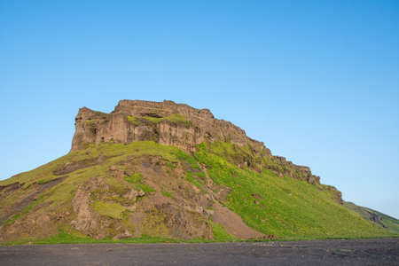 Hjorleifshofdi, a historical promontory in south Iceland on a sunny summer evening Stock Photo - 131321480
