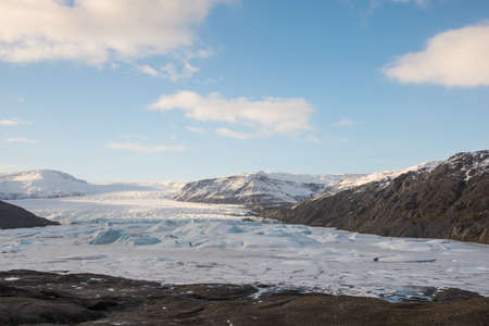 Hoffellsjokull glacier and lagoon in South Iceland on a sunny winter day