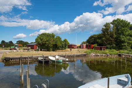 Skaninge bro harbor on island of Bogo in Denmark on a sunny summer day