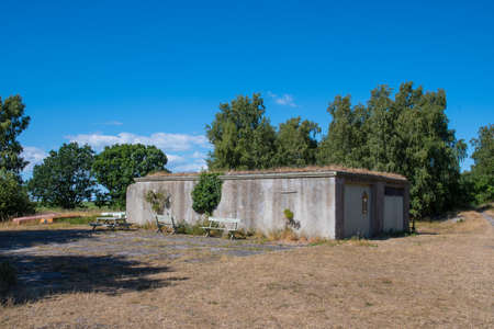 Old industrial building in the danish nature in Ulvshale forest on a summer day Stock Photo