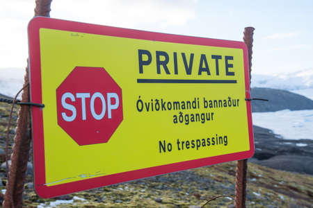 Sign telling that the land is private and that there is no trespassing allowed Stock Photo