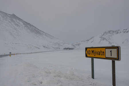 Sign in the Icelandic highlands telling that there are 63 kilometers to the nearest village Myvatn